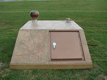 Slope Front Storm Shelters